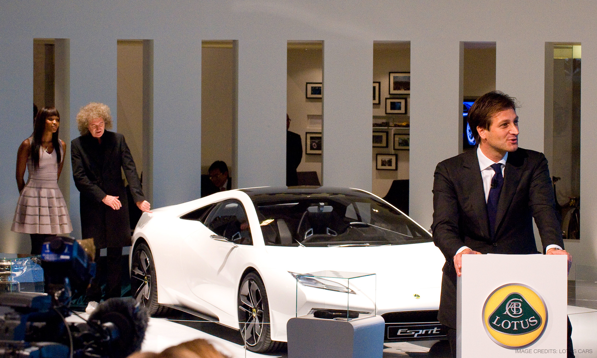 Brian May and Naomi Campbell next to the Lotus Esprit Concept Car at Paris Motor Show 2010